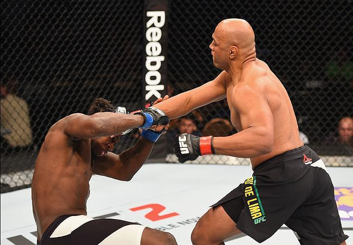 LAS VEGAS, NV - APRIL 23:  (R-L) Marcos Rogerio de Lima of Brazil punches Clint Hester in their light heavyweight bout during the UFC 197 event inside MGM Grand Garden Arena on April 23, 2016 in Las Vegas, Nevada.  (Photo by Josh Hedges/Zuffa LLC/Zuffa LL