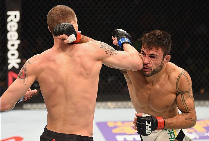 LAS VEGAS, NV - APRIL 23:  (R-L) Glaico Franca of Brazil exchange punches with James Vick in their lightweight bout during the UFC 197 event inside MGM Grand Garden Arena on April 23, 2016 in Las Vegas, Nevada.  (Photo by Josh Hedges/Zuffa LLC/Zuffa LLC v