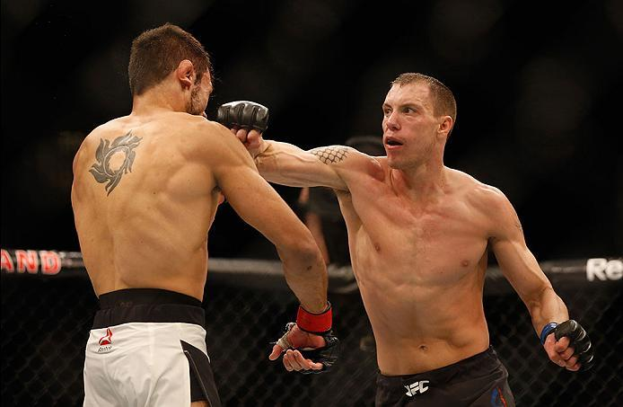 LAS VEGAS, NV - APRIL 23:  (R-L) James Vick punches Glaico Franca in their lightweight bout during the UFC 197 event inside MGM Grand Garden Arena on April 23, 2016 in Las Vegas, Nevada.  (Photo by Christian Petersen/Zuffa LLC/Zuffa LLC via Getty Images)