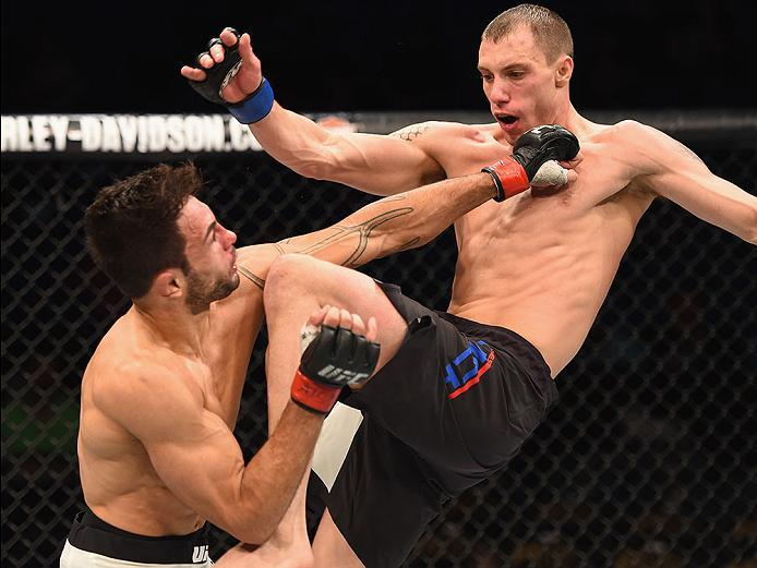 LAS VEGAS, NV - APRIL 23:  (R-L) James Vick knees Glaico Franca of Brazil in their lightweight bout during the UFC 197 event inside MGM Grand Garden Arena on April 23, 2016 in Las Vegas, Nevada.  (Photo by Josh Hedges/Zuffa LLC/Zuffa LLC via Getty Images)