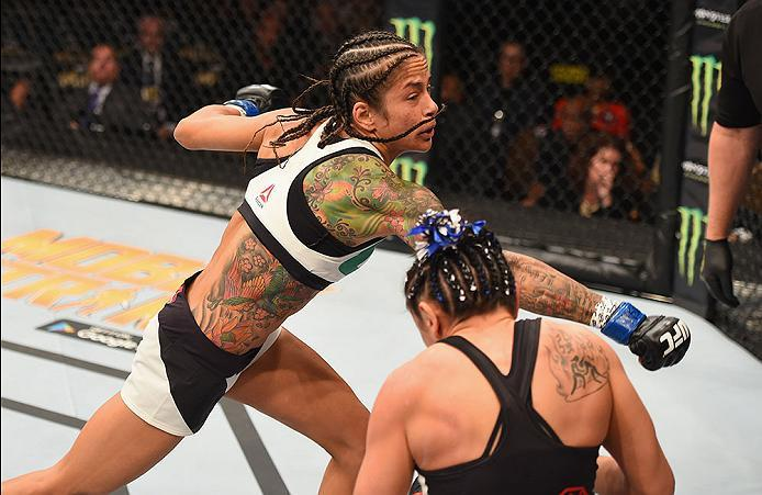 LAS VEGAS, NV - APRIL 23:  (L-R) Juliana Lima punches Carla Esparza in their women's strawweight bout during the UFC 197 event inside MGM Grand Garden Arena on April 23, 2016 in Las Vegas, Nevada.  (Photo by Josh Hedges/Zuffa LLC/Zuffa LLC via Getty Image