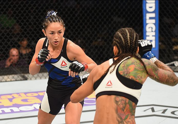 LAS VEGAS, NV - APRIL 23:  (L-R) Carla Esparza squares off against Juliana Lima in their women's strawweight bout during the UFC 197 event inside MGM Grand Garden Arena on April 23, 2016 in Las Vegas, Nevada.  (Photo by Josh Hedges/Zuffa LLC/Zuffa LLC via