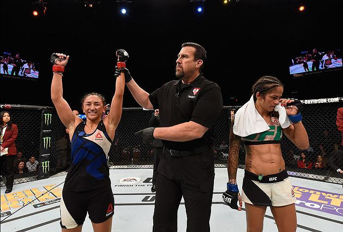 LAS VEGAS, NV - APRIL 23:  (L-R) Carla Esparza celebrates her victory over Juliana Lima in their women's strawweight bout during the UFC 197 event inside MGM Grand Garden Arena on April 23, 2016 in Las Vegas, Nevada.  (Photo by Josh Hedges/Zuffa LLC/Zuffa