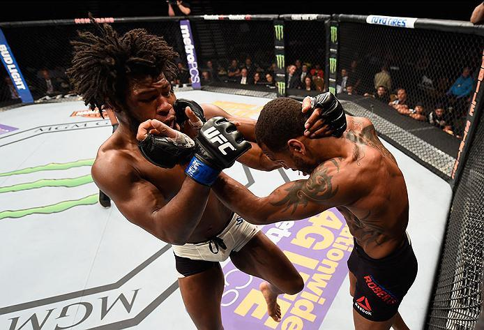 LAS VEGAS, NV - APRIL 23:  (L-R) Dominique Steele exchange punches with Danny Roberts of England in their welterweight bout during the UFC 197 event inside MGM Grand Garden Arena on April 23, 2016 in Las Vegas, Nevada.  (Photo by Josh Hedges/Zuffa LLC/Zuf