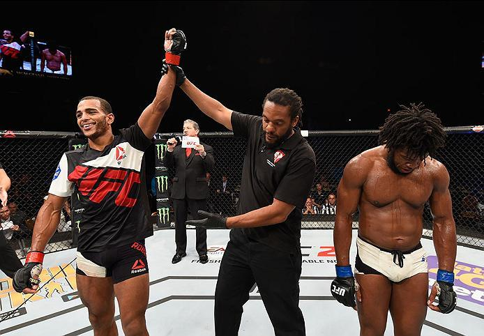 LAS VEGAS, NV - APRIL 23:  (L-R) Danny Roberts celebrates his victory over Dominique Steele in their welterweight bout during the UFC 197 event inside MGM Grand Garden Arena on April 23, 2016 in Las Vegas, Nevada.  (Photo by Josh Hedges/Zuffa LLC/Zuffa LL