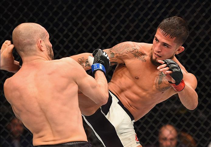 LAS VEGAS, NV - APRIL 23:  (R-L) Sergio Pettis kicks Chris Kelades in their flyweight bout during the UFC 197 event inside MGM Grand Garden Arena on April 23, 2016 in Las Vegas, Nevada.  (Photo by Josh Hedges/Zuffa LLC/Zuffa LLC via Getty Images)