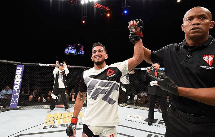 LAS VEGAS, NV - APRIL 23:  Sergio Pettis celebrates his victory over Chris Kelades in their flyweight bout during the UFC 197 event inside MGM Grand Garden Arena on April 23, 2016 in Las Vegas, Nevada.  (Photo by Josh Hedges/Zuffa LLC/Zuffa LLC via Getty