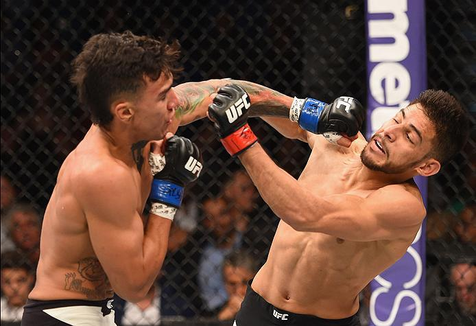 LAS VEGAS, NV - APRIL 23:  (L-R) Andre Fili punches Yair Rodriguez of Mexico in their featherweight bout during the UFC 197 event inside MGM Grand Garden Arena on April 23, 2016 in Las Vegas, Nevada.  (Photo by Josh Hedges/Zuffa LLC/Zuffa LLC via Getty Im