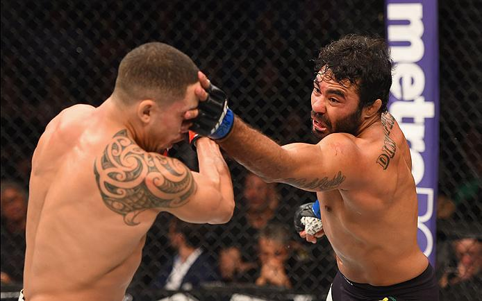 LAS VEGAS, NV - APRIL 23:  (R-L) Rafael Natal covers the face of Robert Whittaker of New Zealand in their middleweight bout during the UFC 197 event inside MGM Grand Garden Arena on April 23, 2016 in Las Vegas, Nevada.  (Photo by Josh Hedges/Zuffa LLC/Zuf