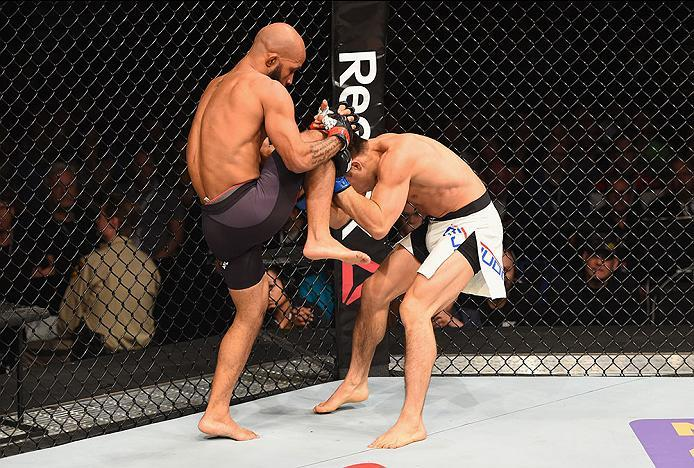 LAS VEGAS, NV - APRIL 23:  (L-R) Demetrious Johnson knees Henry Cejudo in their flyweight championship bout during the UFC 197 event inside MGM Grand Garden Arena on April 23, 2016 in Las Vegas, Nevada.  (Photo by Josh Hedges/Zuffa LLC/Zuffa LLC via Getty