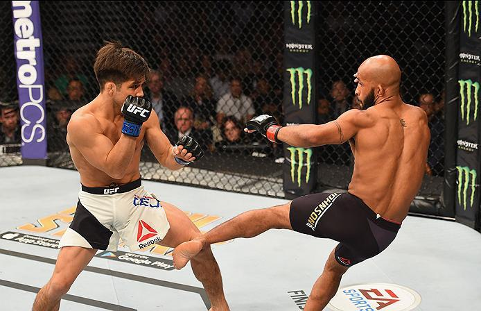 LAS VEGAS, NV - APRIL 23:  (R-L) Demetrious Johnson kicks Henry Cejudo in their flyweight championship bout during the UFC 197 event inside MGM Grand Garden Arena on April 23, 2016 in Las Vegas, Nevada.  (Photo by Josh Hedges/Zuffa LLC/Zuffa LLC via Getty