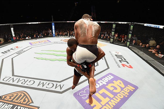 LAS VEGAS, NV - APRIL 23:  (L-R) Jon Jones picks up Ovince Saint Preux in their interim UFC light heavyweight championship bout during the UFC 197 event inside MGM Grand Garden Arena on April 23, 2016 in Las Vegas, Nevada.  (Photo by Josh Hedges/Zuffa LLC