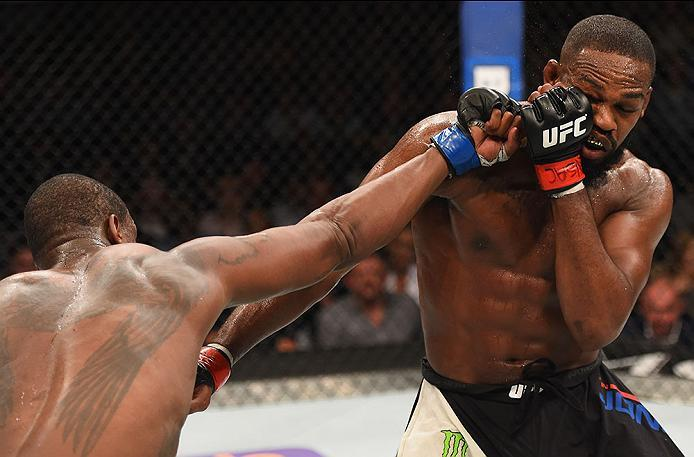 LAS VEGAS, NV - APRIL 23:  (L-R) Ovince Saint Preux punches Jon Jones in their interim UFC light heavyweight championship bout during the UFC 197 event inside MGM Grand Garden Arena on April 23, 2016 in Las Vegas, Nevada.  (Photo by Josh Hedges/Zuffa LLC/