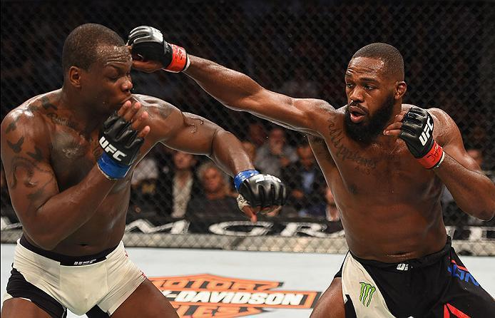 LAS VEGAS, NV - APRIL 23:  (R-L) Jon Jones punches Ovince Saint Preux in their interim UFC light heavyweight championship bout during the UFC 197 event inside MGM Grand Garden Arena on April 23, 2016 in Las Vegas, Nevada.  (Photo by Josh Hedges/Zuffa LLC/