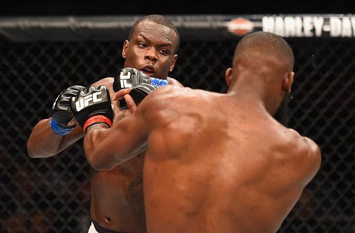 LAS VEGAS, NV - APRIL 23:  (L-R) Ovince Saint Preux exchange punches with Jon Jones in their interim UFC light heavyweight championship bout during the UFC 197 event inside MGM Grand Garden Arena on April 23, 2016 in Las Vegas, Nevada.  (Photo by Josh Hed