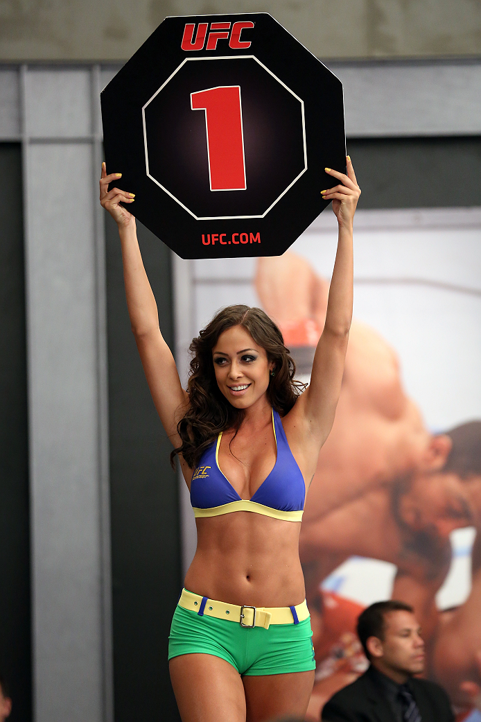 SAO PAULO, BRAZIL - JANUARY 24:  UFC Octagon Girl candidate Ana Cecilia signals the start of round one between Team Wanderlei fighter Ricardo Abreu and Team Sonnen fighter Guilherme de Vasconcelos in their middleweight fight during season three of The Ult