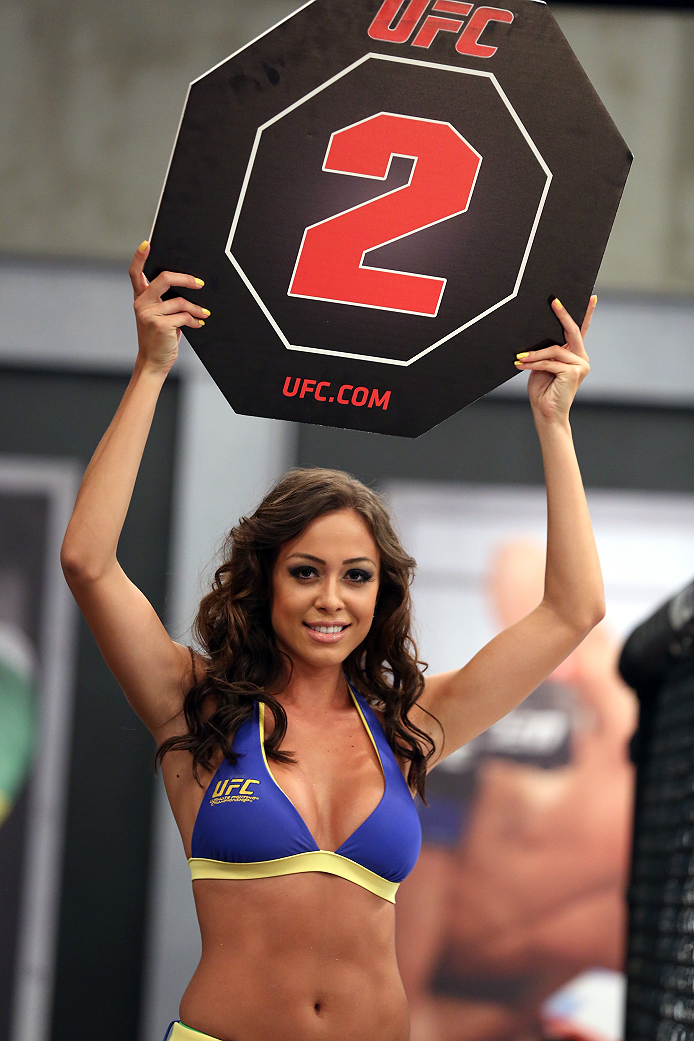SAO PAULO, BRAZIL - JANUARY 24:  UFC Octagon Girl candidate Ana Cecilia signals the start of round two between Team Wanderlei fighter Ricardo Abreu and Team Sonnen fighter Guilherme de Vasconcelos in their middleweight fight during season three of The Ult