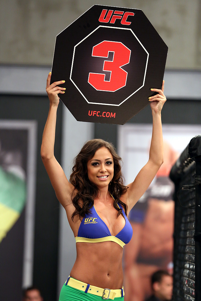 SAO PAULO, BRAZIL - JANUARY 24:  UFC Octagon Girl candidate Ana Cecilia signals the start of round three between Team Wanderlei fighter Ricardo Abreu and Team Sonnen fighter Guilherme de Vasconcelos in their middleweight fight during season three of The U