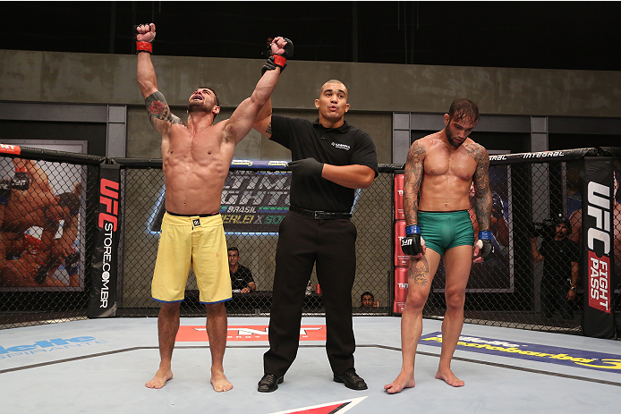 SAO PAULO, BRAZIL - JANUARY 24:  (L-R) Team Wanderlei fighter Ricardo Abreu celebrates after defeating Team Sonnen fighter Guilherme de Vasconcelos in their middleweight fight during season three of The Ultimate Fighter Brazil on January 24, 2014 in Sao P