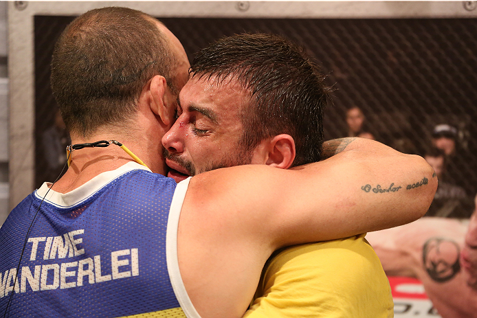 SAO PAULO, BRAZIL - JANUARY 24:  (R-L) Team Wanderlei fighter Ricardo Abreu is embraced by coach Wanderlei Silva after defeating Team Sonnen fighter Guilherme de Vasconcelos in their middleweight fight during season three of The Ultimate Fighter Brazil on