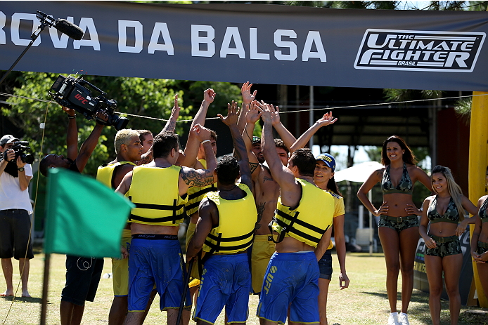 SAO PAULO, BRAZIL - JANUARY 22:  Team Wanderlei celebrate as they beat Team Sonnen to the beach in the water challenge during season three of The Ultimate Fighter Brazil on January 22, 2014 in Sao Paulo, Brazil. (Photo by Luiz Pires Dias/Zuffa LLC/Zuffa L