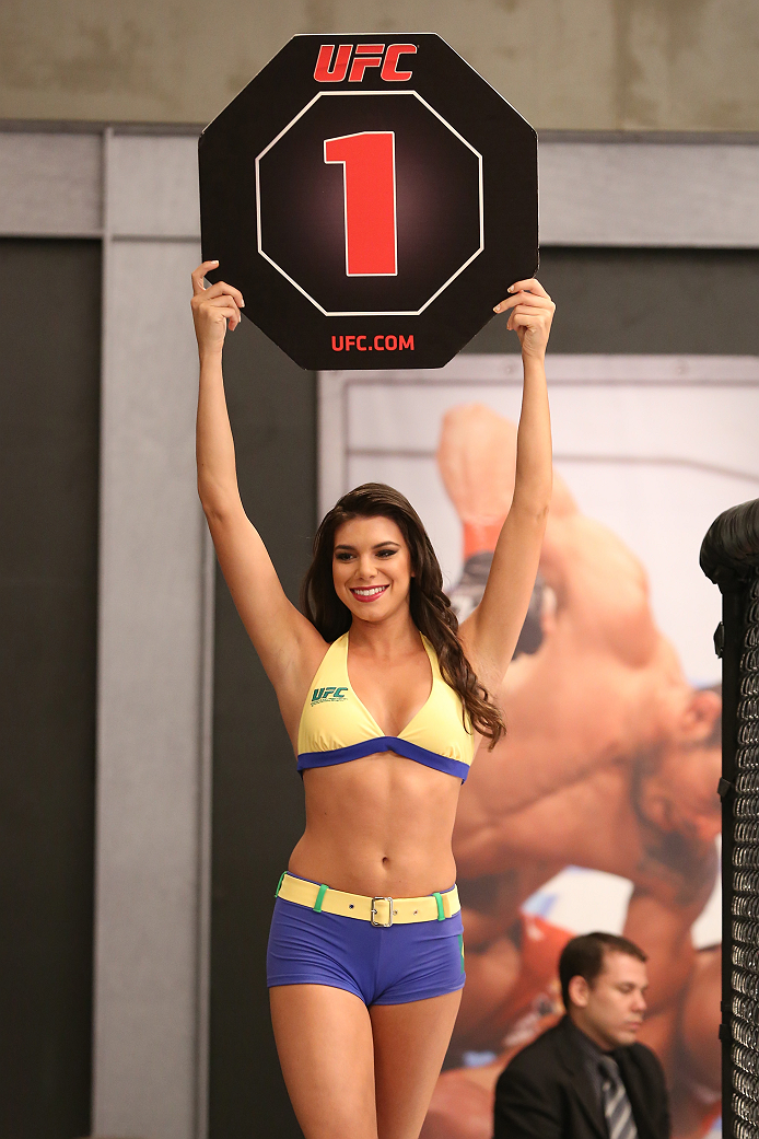 SAO PAULO, BRAZIL - FEBRUARY 4:  UFC Octagon Girl candidate Camila Bortolazzo signals the start of round one between Team Wanderlei fighter Antonio Branjao and Team Sonnen fighter Vitor Mirande in their heavyweight fight during season three of The Ultimat