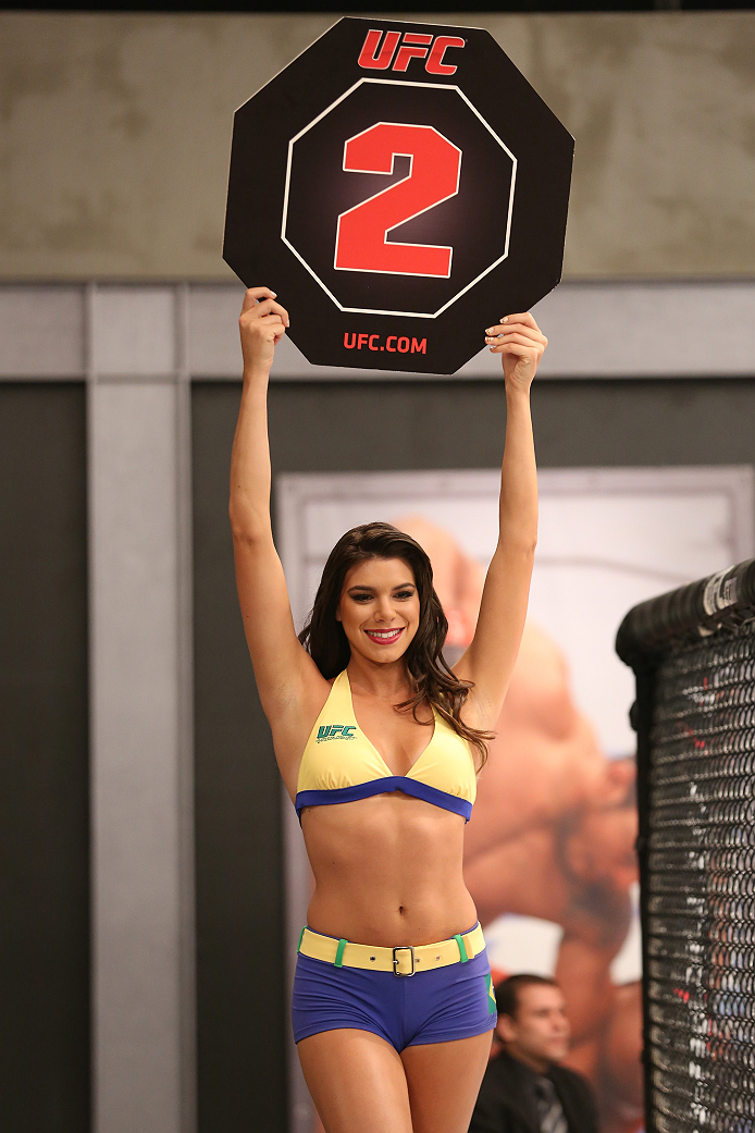 SAO PAULO, BRAZIL - FEBRUARY 4:  UFC Octagon Girl candidate Camila Bortolazzo signals the start of round two between Team Wanderlei fighter Antonio Branjao and Team Sonnen fighter Vitor Mirande in their heavyweight fight during season three of The Ultimat