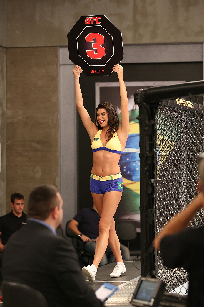 SAO PAULO, BRAZIL - FEBRUARY 4:  UFC Octagon Girl candidate Camila Bortolazzo signals the start of round three between Team Wanderlei fighter Antonio Branjao and Team Sonnen fighter Vitor Mirande in their heavyweight fight during season three of The Ultim