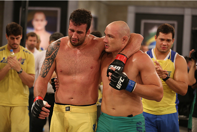 SAO PAULO, BRAZIL - FEBRUARY 4:  (R-L) Team Sonnen fighter Vitor Mirande consoles Team Wanderlei fighter Antonio Branjao after Mirande defeated Branjao by knockout in their heavyweight fight during season three of The Ultimate Fighter Brazil on February 4