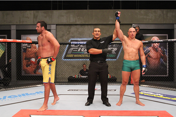 SAO PAULO, BRAZIL - FEBRUARY 4:  (R-L) Team Sonnen fighter Vitor Mirande celebrates after defeating Team Wanderlei fighter Antonio Branjao in their heavyweight fight during season three of The Ultimate Fighter Brazil on February 4, 2014 in Sao Paulo, Braz