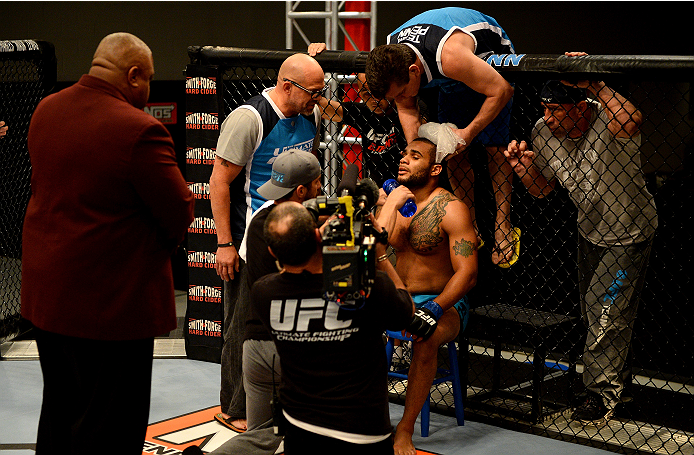 LAS VEGAS, NV - NOVEMBER 8:  Team Penn fighter Roger Zapata gets advice form his corner in between rounds with team Edgar fighter Joseph Stephens in their preliminary fight during filming of season nineteen of The Ultimate Fighter on November 8, 2013 in L