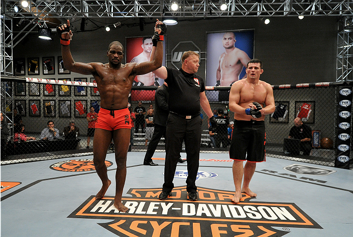 LAS VEGAS, NV - NOVEMBER 21: (L-R) Team Edgar fighter Corey Anderson celebrates his victory team Edgar fighter Patrick Walsh in their semi-final fight during filming of season nineteen of The Ultimate Fighter on November 21, 2013 in Las Vegas, Nevada. (Ph