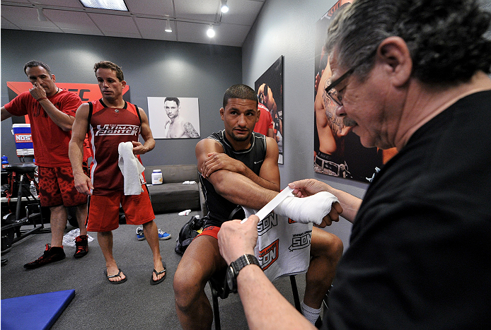 LAS VEGAS, NV - NOVEMBER 21:  Team Edgar fighter Dhiego Lima gets his hands wrapped before facing team Penn fighter Roger Zapata in their semi-final fight during filming of season nineteen of The Ultimate Fighter on November 21, 2013 in Las Vegas, Nevada.