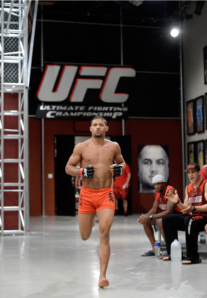 LAS VEGAS, NV - NOVEMBER 21:  Team Edgar fighter Dhiego Lima runs out to the Octagon before facing team Penn fighter Roger Zapata in their semi-final fight during filming of season nineteen of The Ultimate Fighter on November 21, 2013 in Las Vegas, Nevada