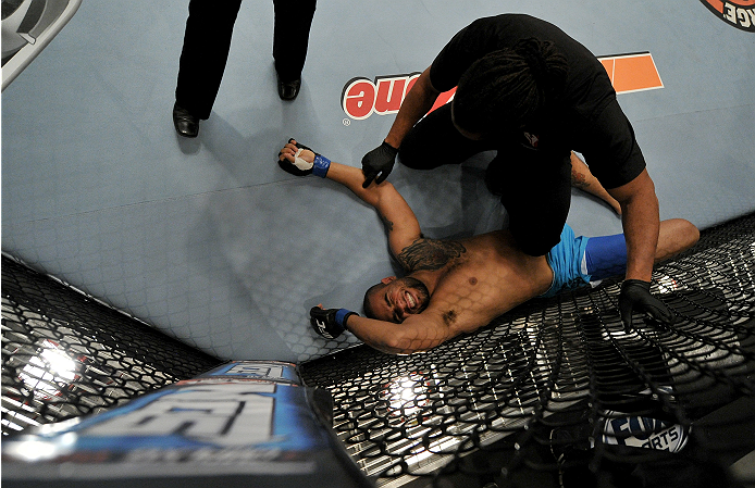LAS VEGAS, NV - NOVEMBER 21:  Team Penn fighter Roger Zapata grimaces in pain after being tapped out by team Edgar fighter Dhiego Lima in their semi-final fight during filming of season nineteen of The Ultimate Fighter on November 21, 2013 in Las Vegas, N