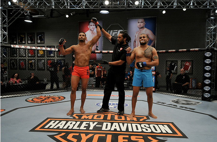 LAS VEGAS, NV - NOVEMBER 21:  (L-R) Team Edgar fighter Dhiego Lima celebrates his win over team Penn fighter Roger Zapata in their semi-final fight during filming of season nineteen of The Ultimate Fighter on November 21, 2013 in Las Vegas, Nevada. (Photo