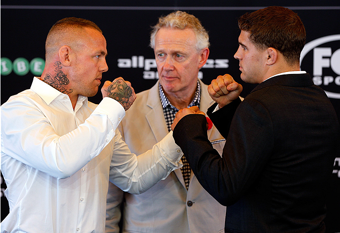 SYDNEY, AUSTRALIA - NOVEMBER 06:  (L-R) Opponents Ross Pearson of England and Al Iaquinta of the United States face off during the UFC Fight Night press conference at the Opera Point Marquee on November 6, 2014 in Sydney, Australia. (Photo by Josh Hedges/