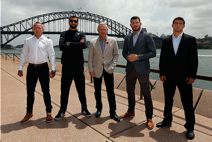 SYDNEY, AUSTRALIA - NOVEMBER 06:  (L-R) Lightweight Ross Pearson of England, middleweight Luke Rockhold of the United States, UFC Managing Director Tom Wright, middleweight Michael Bisping of England, and lightweight Al Iaquinta of the United States pose