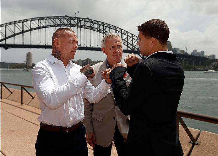 SYDNEY, AUSTRALIA - NOVEMBER 06:  (L-R) Opponents Ross Pearson of England and Al Iaquinta of the United States face off in front of the Sydney Harbour Bridge during the UFC Fight Night press conference at the Opera Point Marquee on November 6, 2014 in Syd