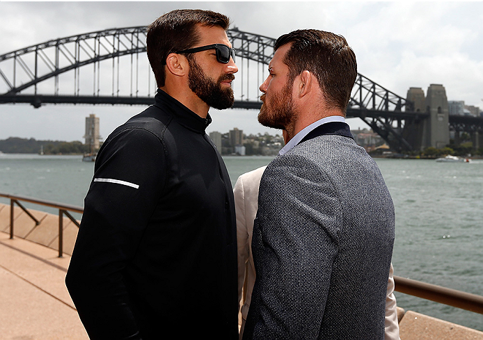 SYDNEY, AUSTRALIA - NOVEMBER 06:  (L-R) Opponents Luke Rockhold of the United States and Michael Bisping of England face off in front of the Sydney Harbour Bridge during the UFC Fight Night press conference at the Opera Point Marquee on November 6, 2014 i