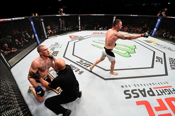 OTTAWA, ON - JUNE 18:   (R-L) Colby Covington of the United States celebrates his submission victory over Jonathan Meunier of Canada in their welterweight bout during the UFC Fight Night event inside the TD Place Arena on June 18, 2016 in Ottawa, Ontario,