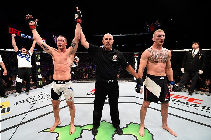 OTTAWA, ON - JUNE 18:   (L-R) Colby Covington of the United States celebrates his submission victory over Jonathan Meunier of Canada in their welterweight bout during the UFC Fight Night event inside the TD Place Arena on June 18, 2016 in Ottawa, Ontario,