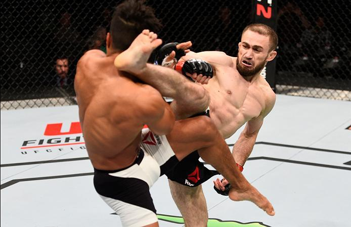 OTTAWA, ON - JUNE 18:   (R-L) Ali Bagautinov kicks Geane Herrera  in their flyweight bout during the UFC Fight Night event inside the TD Place Arena on June 18, 2016 in Ottawa, Ontario, Canada. (Photo by Jeff Bottari/Zuffa LLC/Zuffa LLC via Getty Images)