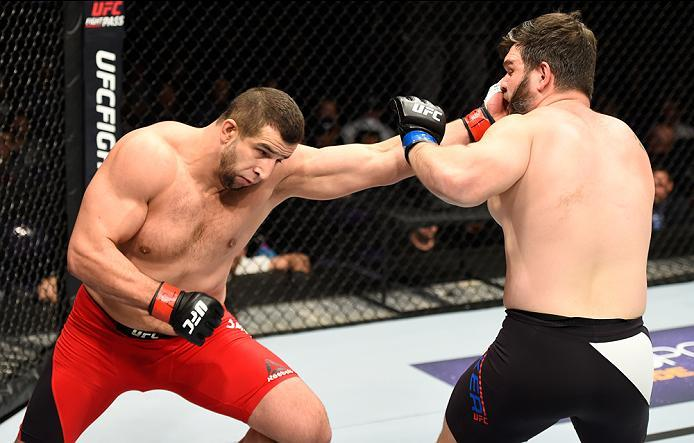 PHOENIX, AZ - JANUARY 15:  (L-R) Dmitrii Smoliakov of Russia punches Cyril Asker of France in their heavyweight bout during the UFC Fight Night event inside Talking Stick Resort Arena on January 15, 2017 in Phoenix, Arizona. (Photo by Jeff Bottari/Zuffa L