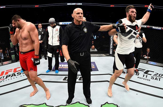PHOENIX, AZ - JANUARY 15:  (R-L) Cyril Asker of France celebrates his victory over Dmitrii Smoliakov of Russia in their heavyweight bout during the UFC Fight Night event inside Talking Stick Resort Arena on January 15, 2017 in Phoenix, Arizona. (Photo by