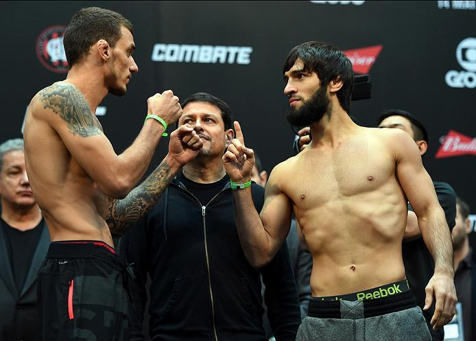 CURITIBA, BRAZIL - MAY 13:  (L-R) Opponents Renato Moicano of Brazil and Zubaira Tukhugov of Russia face off during the UFC 198 weigh-in at Arena da Baixada stadium on May 13, 2016 in Curitiba, Parana, Brazil.  (Photo by Josh Hedges/Zuffa LLC/Zuffa LLC vi