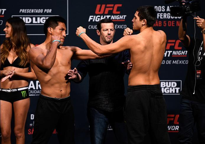 MEXICO CITY, MEXICO - NOVEMBER 04:  (L-R) Enrique Barzola of the Peru and Chris Avila of the United States face off during the UFC weigh-in at the Arena Ciudad de Mexico on November 4, 2016 in Mexico City, Mexico. (Photo by Jeff Bottari/Zuffa LLC/Zuffa LL