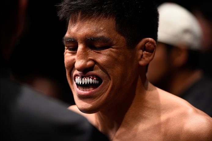 MEXICO CITY, MEXICO - NOVEMBER 05:  Enrique Barzola of Peru prepares to enter the Octagon before facing Chris Avila of the United States in their featherweight bout during the UFC Fight Night event at Arena Ciudad de Mexico on November 5, 2016 in Mexico C