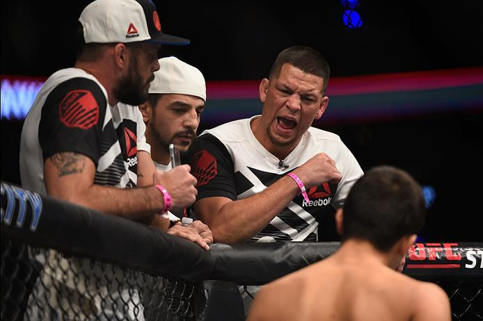 MEXICO CITY, MEXICO - NOVEMBER 05:  Nate Diaz yells at his teammate Chris Avila of the United States as he enters the Octagon before facing Enrique Barzola of Peru in their featherweight bout during the UFC Fight Night event at Arena Ciudad de Mexico on N