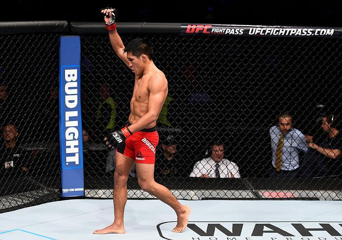 MEXICO CITY, MEXICO - NOVEMBER 05:  Enrique Barzola of Peru raises his hand after facing Chris Avila of the United States in their featherweight bout during the UFC Fight Night event at Arena Ciudad de Mexico on November 5, 2016 in Mexico City, Mexico. (P